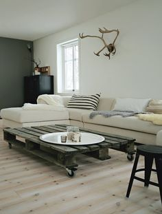 Old pallet coffee table on wheels