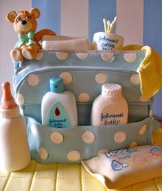 A baby bag cake made of striped blue, white & yellow vanilla sponge with hand painted rice paper labelling!