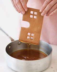 "The secret to sticking a gingerbread house together! Swedish Gingerbread House Recipe, a caramel syrup serves as the ""glue."" To assemble: Dip one edge of front piece in caramel, and allow excess to drip off. Coat only the edge that will be joined. Christmas Goodies, Christmas Treats, Holiday Treats, Holiday Recipes, Christmas Holidays, Xmas, Christmas Recipes, Christmas Decor, Winter Treats"