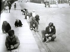 "Kids collecting shrapnel in a London Sreet - World War 2. The true meaning behind ""KEEP CALM AND CARRY ON""."