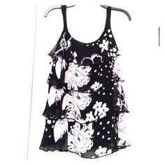 Black and White Ruffled Tank Adorable black and white flowered top. 4 layers of Ruffles. Never worn! Lapis Tops Tank Tops