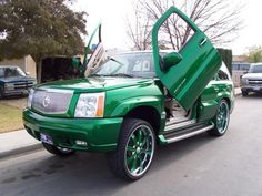 Just had to do it...Lamborghini doors on the Escalade, that's awesome!