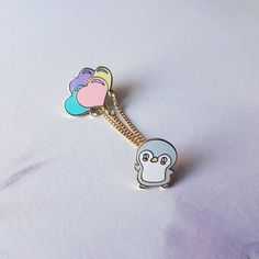 """Repost @booppins """"Flying"""" Penguin pin now available in my shop! This is my addition to the Flock of Friends collaboration with @fauxfoxstudio @malzpalznyc @triangleofbears & @bravekidsclub. This pin is actually two pins in one! The balloons are detachable (by chain and jump ring) so you can put them on any pin you would like! Photo by @triangleofbears #pins #pingame #birds #birdsofinstagram #flockoffriends #fly #wings #penguin #balloons #hummingbird #pigeon #parrot #cockatiel #pingamesgrong…"""