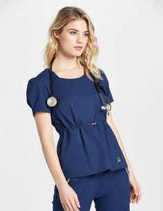 The Cinched Waist Top in Estate Navy Blue is a contemporary addition to women's medical scrub outfits. Shop Jaanuu for scrubs, lab coats and other medical apparel. Doctor Scrubs, Stylish Scrubs, Scrubs Outfit, Nurse Costume, Medical Uniforms, Professional Wear, Medical Scrubs, Spa Uniform, Lab Coats