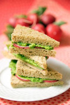 Green Pea Avocado Radish Sandwiches: Peas, avocados, lime juice and cayenne pepper come together for a pea centric spin on guacamole. The sweet pea guacamole is balanced by spicy sliced radishes and whole grain bread in these bright tea sandwiches. #MeatlessMonday #Lunch