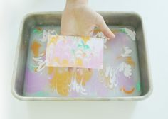 DIY Marbled paper...using liquid starch, alum, paint, dish soap and water!