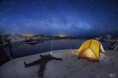 """""""Be Where You Are""""   Ben Canales ------------------ Entry for Astronomy Photographer of the Year: This is a single exposure image. Tent lit by lantern. Milky Way lays low on horizon. Crater Lake National Park, Oregon, USA"""