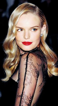 Kate Bosworth looked glam with red lips and soft waves.