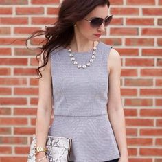 Textured, black and white peplum top paired with dark skinny jeans, black leather sandals, and a snake-embossed clutch.