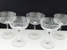 Vintage champagne saucers etched champagne glasses by peonyandthistle from peonyandthistle on Etsy. Saved to Vintage Wedding . Vintage Champagne Glasses, Champagne Saucers, Wine Glass, Glass Art, Art Deco, Glass Etching, Etched Glass, Antique Glassware, Glass Design