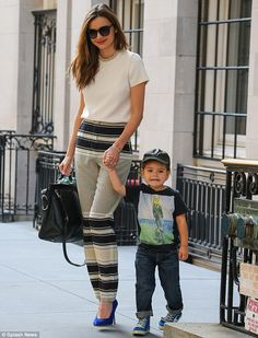 Her little man: Miranda Kerr looks perfectly put together in black and beige as she takes her son Flynn out on Friday in New York City
