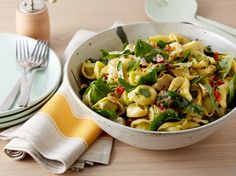 Spinach Artichoke Pasta Salad : Toss tender tortellini with spinach, artichoke hearts and roasted red peppers for a satisfying pasta salad. For an extra dose of protein, try tortellini stuffed with chicken. For a vegetarian dish, go for the mushroom- or spinach-stuffed variety. via Food Network