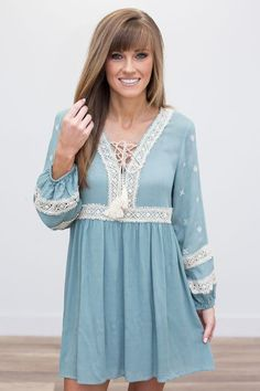 """Long sleeve dress with bubble sleeves, floral embroidery, lace up tassel ties, and lace details. Fully lined. Cotton/polyester. Dry clean only.Sleeves measure 22"""""""" from shoulder. Measurements from sh"""