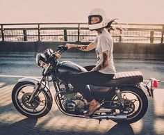 It's way hotter to see a girl actually riding a motorcycle with clothes on than to see one leaning on one without.