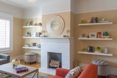 Floating shelves on both sides of the fireplace give a sense of balance and harmony.
