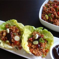Asian Lettuce Wraps Allrecipes.com substitute cabbage and water chestnuts for the tofu, use more garlic than called for and leave out the vegetable oil, use low carb Hoisin sauce  Ingredients:  1 pound ground pork  1 bunch green onions, thinly sliced  1/2 teaspoon minced garlic  3 tablespoons hoisin sauce  2 tablespoons soy sauce  1 teaspoon sesame oil  1/4 teaspoon hot chile paste  1 head iceberg lettuce leaves, separated