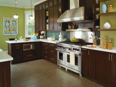 Premium cherry cabinets by Omega, complemented by white countertops, stainless steel appliances and a patterned tile floor give this family's kitchen a warm and inviting feel, while still offering plenty of room to cook.  Cabinetry storage is plentiful as well, and the Plainfield cabinet door style in Truffle finish, mixed with luxury glass cabinets, keep this kitchen bright and efficient. http://www.omegacabinetry.com/