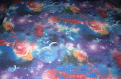 "Blue galaxy cosmos planets 2 way stretch poly lycra fabric 54"" wide sold by the yard"