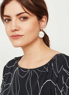 Embrace the statement accessory trend with these silver-tone double disc earrings. A modern geometric shape for the ultimate minimalist vibe. The drop measures 4cm/1.5in. In the interest of hygiene, earrings are non-returnable.
