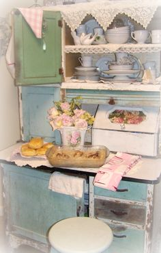 I have this exact baker's cabinet! Mine is dark green, but Jimmy is going to refinish it after he's done with the matching china cabinet.