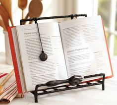 This stylish cookbook holder is sturdy enough to prop up even your largest cookbook with a cute fork ledge and weighted chains to hold your page. Never lose your page again! (Pottery Barn, $44)