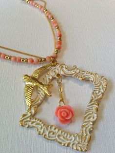 One Of a Kind Handmade Accessories!   Picture Frame Necklace with Bird and Rose. $25.00, via Etsy.