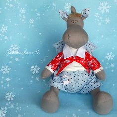 Free Pattern for making this darling dragon...(I don't see the clothes patterns...but isn't he cute...?!