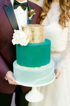 modern wedding cake in gold, green and marble