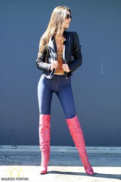 Pink OTK Boots with Back-Zip, 5inch Heel Height and 20inch bootleg length. Tight blue jeans and black leather jacket. #highheelbootsknee #blackhighheelsoutfit