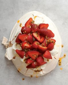 Our Strawberry-Passion Fruit Pavlova – a baked meringue dessert – is piled high with whipped cream and fresh fruit.