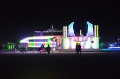 Participants flock around an art installation during the night on Aug. 28.