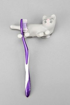 Cat Toothbrush Holder - Urban Outfitters Kinda looks like e brush is rushing the cat bum. Not sure that's where I want my brush before I put it in my mouth . Cat Lover Gifts, Cat Gifts, Cat Lovers, Crazy Cat Lady, Crazy Cats, Cat Decor, Technology Gadgets, Cleaning Wipes, Cool Stuff