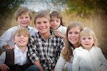 Nice pose for a family photo - get rid of extraneous & show all the faces :)