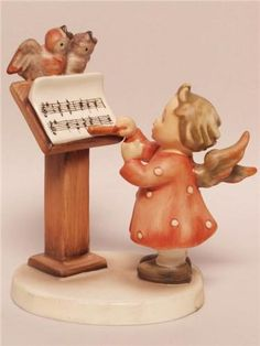 "My adopted grandmother collected Hummel figurines and I remember gazing at them with delight. Years later I bought her this figurine while I was visiting Germany. It is called ""Bird Duet"", number 169. It was first introduced in 1945. At her death, Mrs. Simmers' family gave me the figurine."