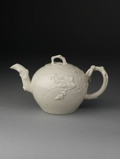 Place of origin: Staffordshire, England (made)  Date: ca. 1750 (made)  Artist/Maker: Unknown (production)  Materials and Techniques: Salt-glazed stoneware with sprigged decoration and moulded