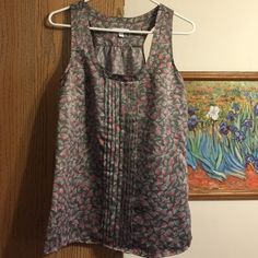 Gap top Beautiful and used once it doesn't fit me anymore. Can give a professional or casual look. GAP Tops Tank Tops