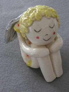 Sitting Ceramic Angel in a Dress with Flowers by TatjanaCeramics, $30.00