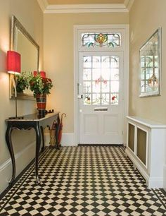 A foyer table is a traditional way to warm up an entrance space and show guests your style and interests. No matter how big or small the space, a foyer table adds definition to the area and makes the entrance to the home feel welcoming. Hallway Flooring, Hallway Walls, Hallway Paint, Tiled Hallway, Hall Tiles, Linoleum Flooring, Small Entryways, Small Hallways, Halls Pequenos