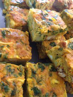 Tajine!  Eggs, chicken, cheese, potatoes, parsley, tabil carwiya, salt, pepper, garlic. You can Use any meat you like.
