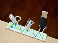 Rooting around for a charging cord lost behind your desk is a small chore, sure — but still a total pain. Thread cords through binder clips on the edge of the surface, and they'll always be within reach. See more at It's Overflowing » - GoodHousekeeping.com