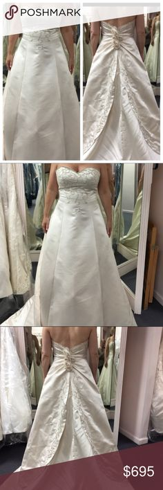 """NWOT Demetrius champagne satin wedding gown Sample from a bridal shop in NYC. Never worn or altered (only try-ons). Waist about 34"""" (I'm an 8 in a regular dress). Loved it but got married in summer so wore a lighter dress. Champagne colored satin (photos look ivory but it's champagne) with tulle underskirt for fullness. Beautifully embroidered bodice, train and apron back. Silk roses along the zipper. Minimal beading along top edge & scattered in the gold embroidery. Needs cleaning/pressing…"""