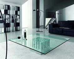 Stylish and uniquely contemporary Scacco glass coffee table designed by Phillip Jackson.  The clear glass top is balanced on a superb white carrara marble structured block base.  A truly original centrepiece for any living room.  In 2 sizes square and 1 size rectangular.