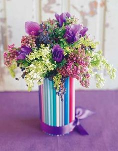 Hot-glue coloured pencil or straws to a glass jar or vase and magnify the colours with hues of floral blooms. Gorgeous!