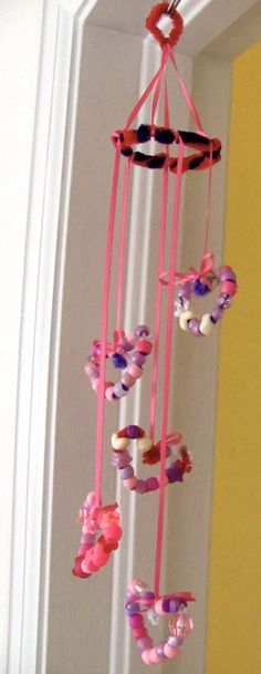 Kids Craft: Beaded heart Mobile. This was a Valentines craft but I think some little girls might want it hanging in their room all year round.