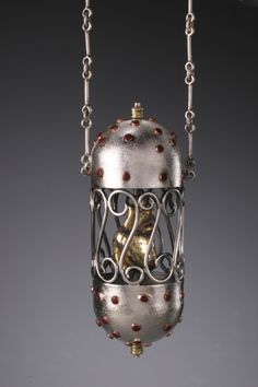 Lorena Lazard, Artist, Spinning Heart, fabricated pendant, 2007  sterling silver, pure silver, copper, 24K gold, gesso, acrylic paint  8 x 3 x 3 cm