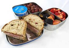 Easy lunch box ideas: veal and turkey patty with sour cream and barbecue sauce on whole-grain bread; grapes, plums and strawberries; Greek yogurt