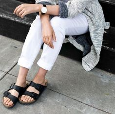 Stoop style in comfy Birks, white jeans, and long cardigan.