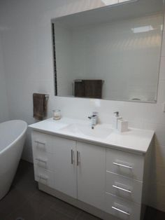Allign your mirror with the length of your vanity and you can't go wrong! Symmetry and clean lines are key in the bathroom - not to mention getting the tiles right! Clean Lines, Double Vanity, Bathrooms, Tiles, Cleaning, Key, Mirror, Toilets, Wall Tiles