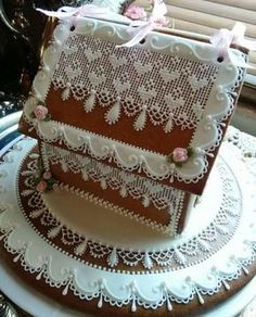Gingerbread house intricately hand piped lace roses and needlepoint