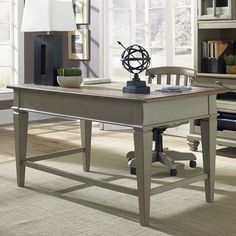 Showcasing English dovetail construction and a flip-down keyboard tray, this taupe-hued desk is an essential addition to your home office or library.